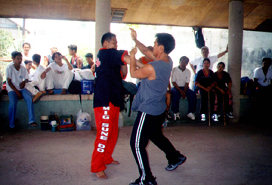 "Master Alberto ""Jhun"" Dacayana JR and student during a demonstration."